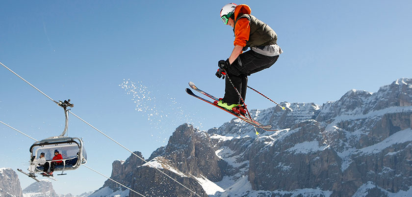 Italy_The-Dolomites-Ski-Area_Selva_Skier-action-jump.jpg